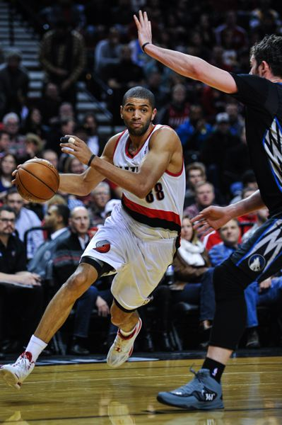 Blazers forward Nicolas Batum tries to drive on Minnesota's Kevin Love.