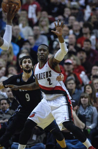 Portland guard Wesley Matthews calls for the ball as Minnesota's Ricky Rubio tries to stay in contact.