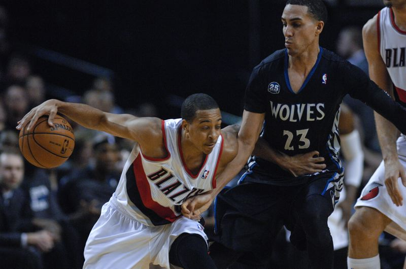 Guard C.J. McCollum goes on the dribble against Kevin Martin of the Timberwolves.
