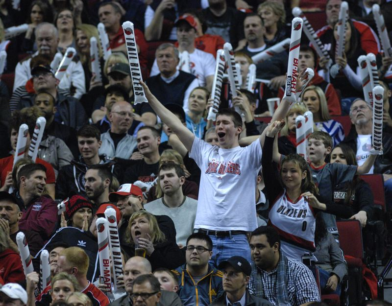 Blazers fan celebrate one of their team's second-half run en route to victory on Saturday.