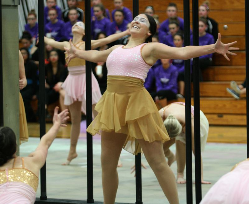 by: PHOTO BY: BRIAN MONIHAN - Clackamas High School's Cavalettes dance team uses veils in a perfromance that caught the eye of judges on Saturday.