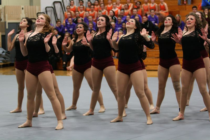 by: PHOTO BY: BRIAN MONIHAN - Oregon City High School Jets look like they are in pain during their choreography this past weekend.