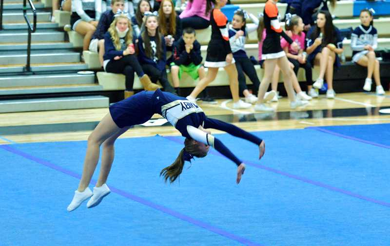 by: DAVE O'SHAUGHNESSY - Kiersten O'Shaugnessy performs a 1-minute routine Jan. 18 during a cheerleading competition at Lakeridge High School. The Canby junior took third place.