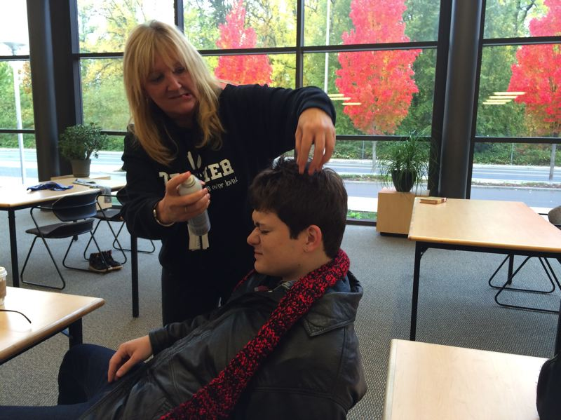 by: PHOTO COURTESY: HOPE ALEXANDER - Sabin-Shellenberg Professional Technical Center teacher Deborah Barnes put the finishing touches on Ryan Coyle for his portrayal of 'The Breakfast Club' character John Bender.