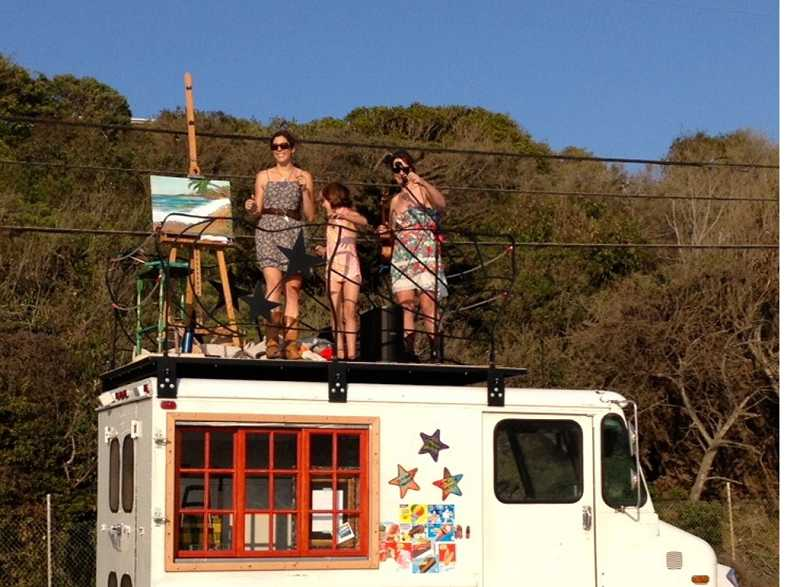 by: SUBMITTED PHOTO -  Jen Harlow, Amelia Stanaway and Amanda Stanway make a stop in Malibu, Calif., last fall for a art and music performance on the platform of a renovated ice cream truck.