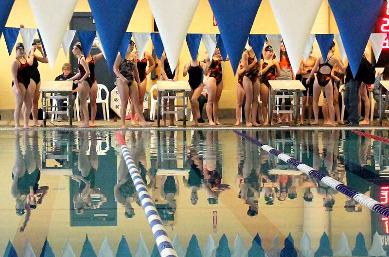 by: CORY MIMMS - Swimmers mingle before the meet.