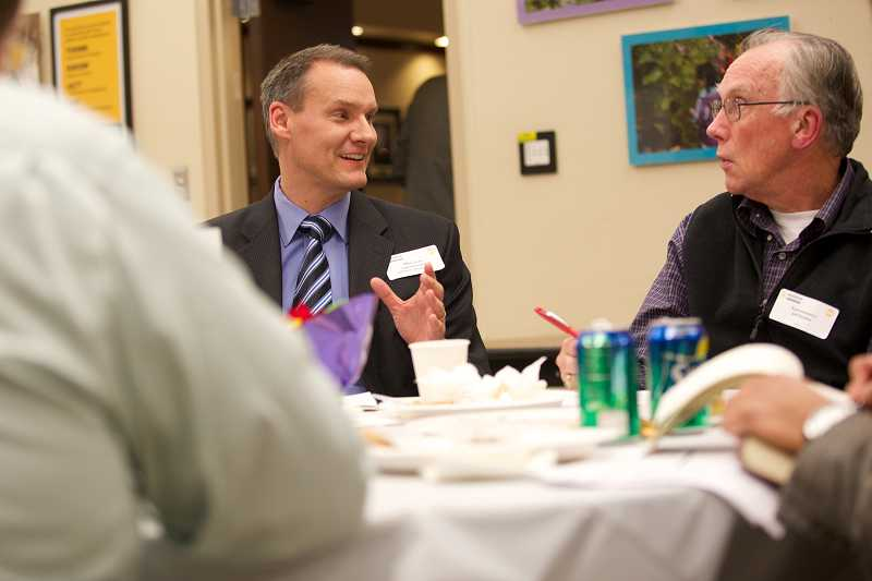 by: TIMES PHOTO: JAIME VALDEZ - Hillsboro School Superintendent Mike Scott talks with state Rep. Jeff Barker during a roundtable discussion about the challenges of unfunded legislative mandates.