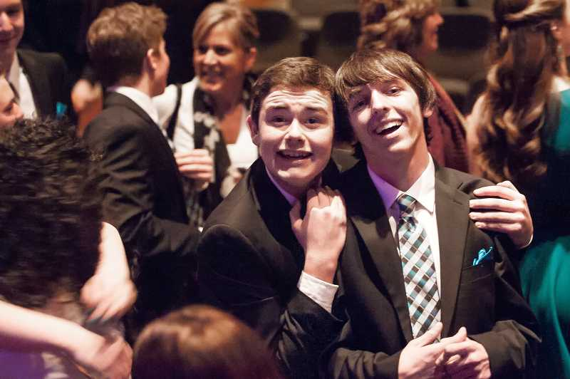 by: SPOKESMAN PHOTO: JOSH KULLA - Soul'd Out members mingle with parents, friends and classmates following their victory Saturday in the ICHSA Western Semifinals at Rolling Hills Church.