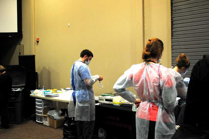 by: NEWS-TIMES PHOTO: STEPHANIE HAUGEN - Pacific University students enrolled in the dental hygiene program saw homeless patients last Friday at Homeless Connect at Sonrise Church in Hillsboro.