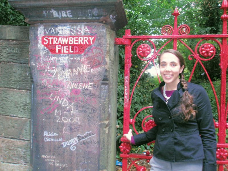 by: COURTESY OF SARAH KELLOGG - Sarah Kellogg, an Aloha High grad working as a financial consultant, stands at the gates of Strawberry Field outside of Liverpool, England - a place that inspired John Lennon's song. Her interest in the Beatles led to a master's degree in the Fab Four.