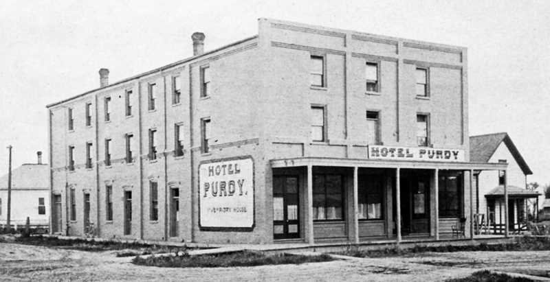 by: COURTESY OF THE GEORGE FOX UNIVERSITY ARCHIVES - A vision of the past - The Hotel Purdy was located at the corner of Main and Sheridan streets in Newberg. The building has long since been razed.
