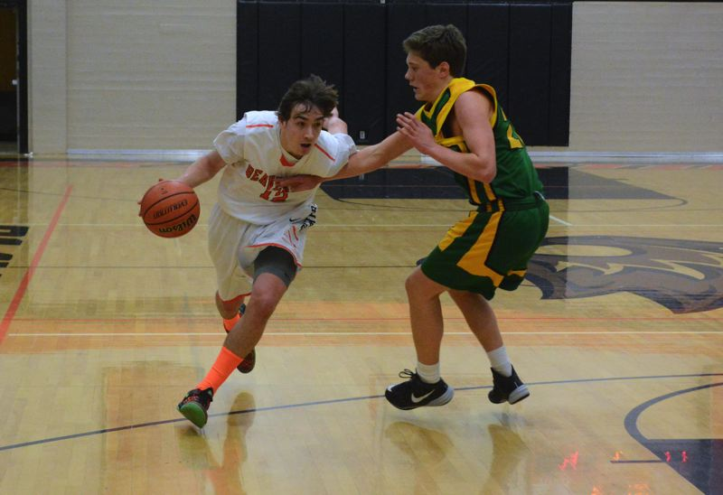 by: TIMES FILE PHOTO - Beaverton senior guard Ty Peacock and the Beavers want to climb up the Metro League standings this season and contend for a conference crown.