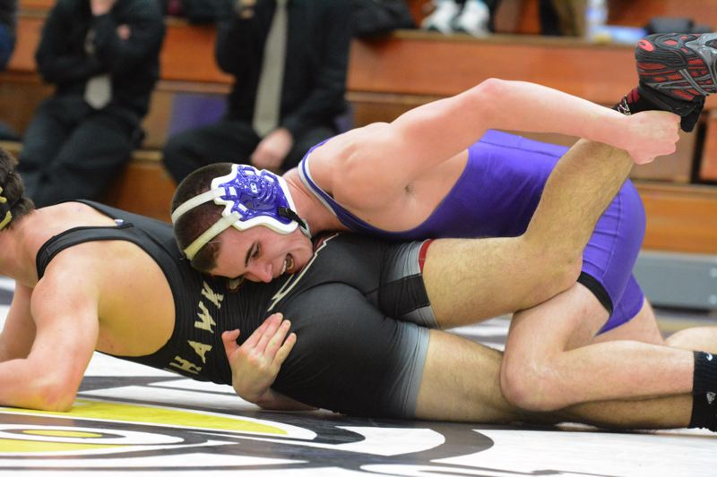 by: TIMES PHOTO: MATT SINGLEDECKER - Sunset 170-pound senior Nathan Burnett beat Southridges Jordan McRae by major decision on Thursday to help the Apollos upend the Skyhawks.