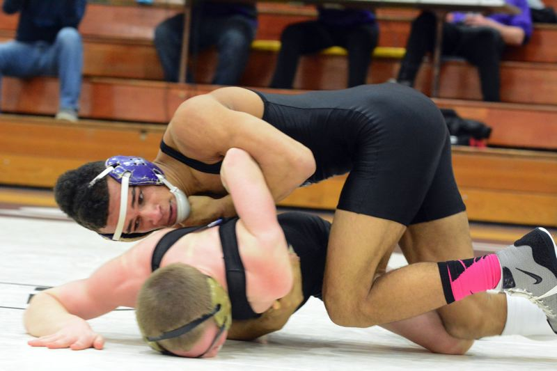 by: TIMES PHOTO: MATT SINGLEDECKER - Sunset 152-pound wrestler Spencer Stokes scored a takedown in the final 30 seconds to beat Southridges Nathan Piwonka on Thursday.
