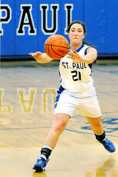 by: SETH GORDON - Swing it - Jessica Wilmes fires off a chest pass late in St. Paul's 48-40 loss to visiting Damascus Christian on Jan. 23.