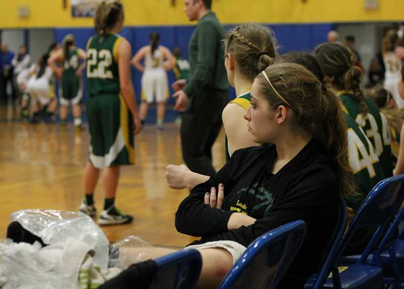 by: CORY MIMMS - Caitlyn Weinberger ices her ankle. She is out for the rest of the season, Coach Kyle Gilstad said.