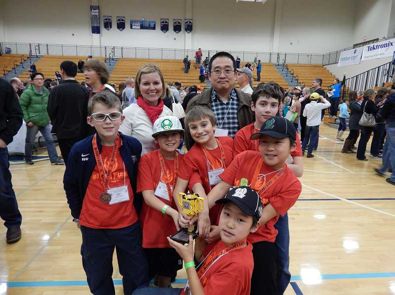 by: SUBMITTED PHOTO - Melting Plastic, a team from Three Rivers Charter School, earned second place for their programming during the Lego robotics state competition held Jan. 18. Back row, coach Kerry Sovde and mentor Songtao Xia. Middle row, from left, Ethan Sovde, Evan Khoo, Ethan Walhood and Zach Gilburne. In front, Victor Xia and Eric Xia (kneeling).