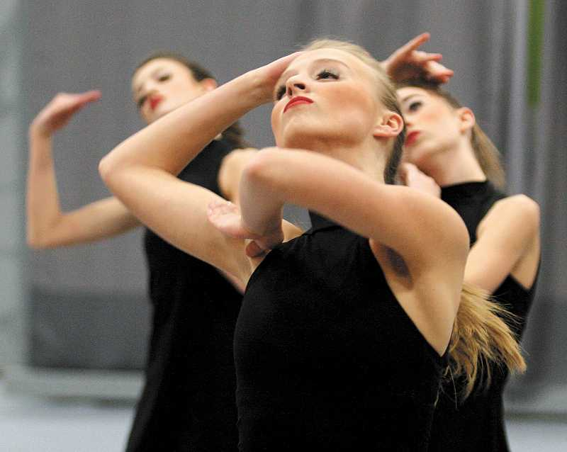 by: TIDINGS PHOTO: J. BRIAN MONIHAN - From left, sophomore Jori Monihan, sophomore Emma Hansen and freshman Nell Egan perform at the Canby Winter Festival of Dance Jan. 25.