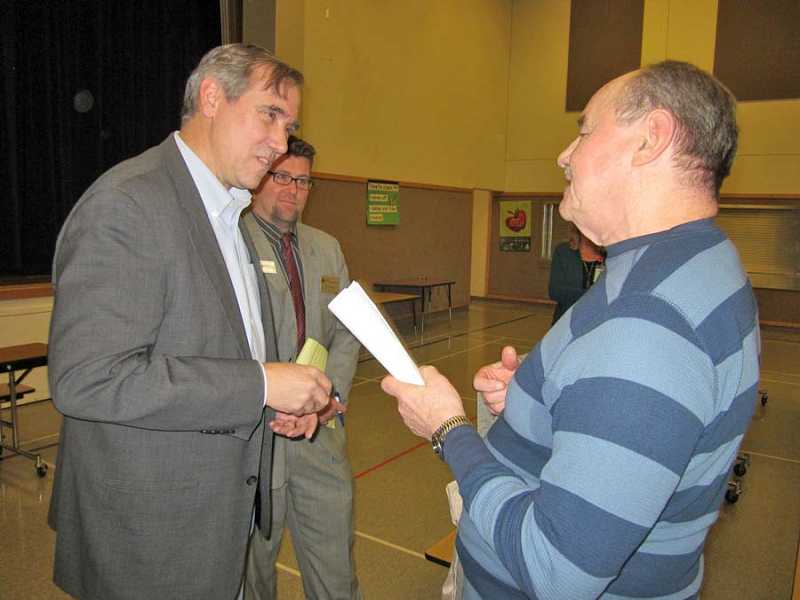by: BARBARA SHERMAN - TAKING TIME TO LISTEN - Following his town hall at Deer Creek Elementary, Sen. Jeff Merkley talked individually with several people, including Richard Uhing of Forest Grove, about issues of importance to them.