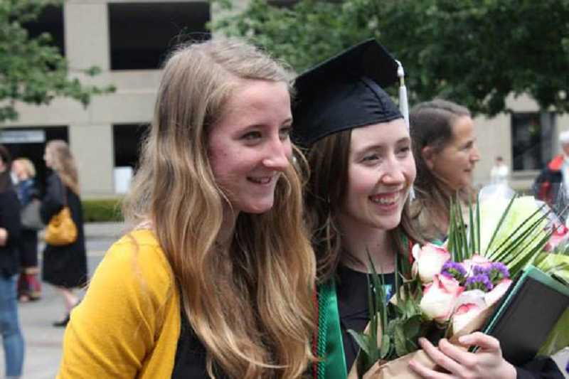 by: SUBMITTED PHOTO - After the Portland State University graduation ceremony in June 2013, Melissa Wilk, right, poses with her sister, Jessica Pollard.