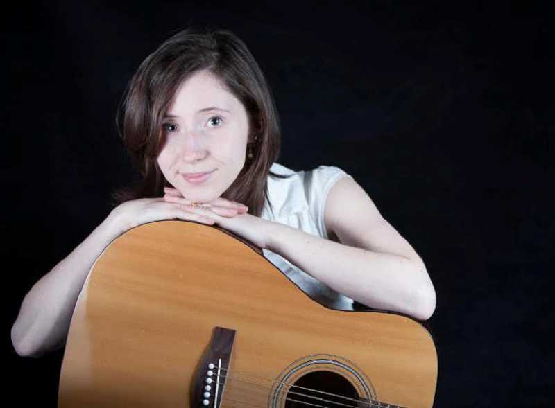 by: SUBMITTED PHOTO - Melissa Wilk has played the guitar for eight years.