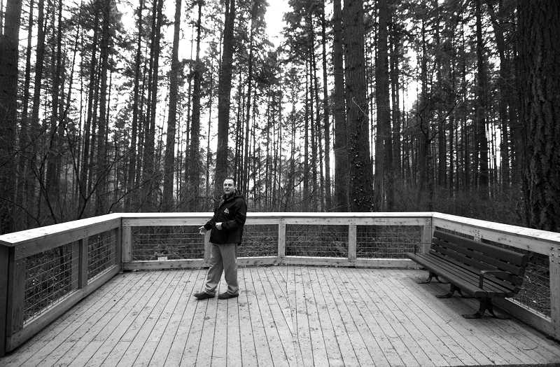 by: TIMES PHOTO: JONATHAN HOUSE - Matt Kilmartin, Tualatin Hills Park and Recreation District project manager for the Lowami Hart Woods renovation, shows off the park's new viewing deck.