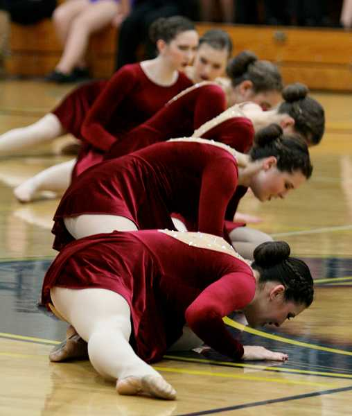 by: REVIEW PHOTO: J. BRIAN MONIHAN - The Pacer Dance Team has pre-qualified for state.