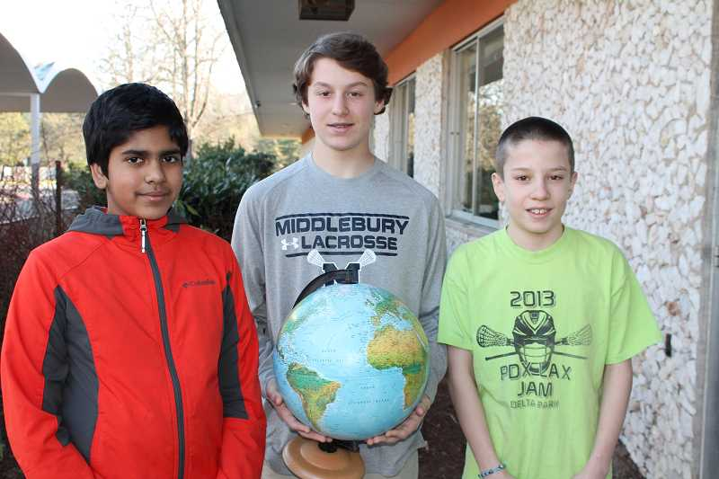 by: REVIEW PHOTO: JILLIAN DALEY - Lakeridge Junior High students, from left, Karthik Sreedhar, Gus Hearn and Mathew Ragsdale were the top three at their schools geography bee.