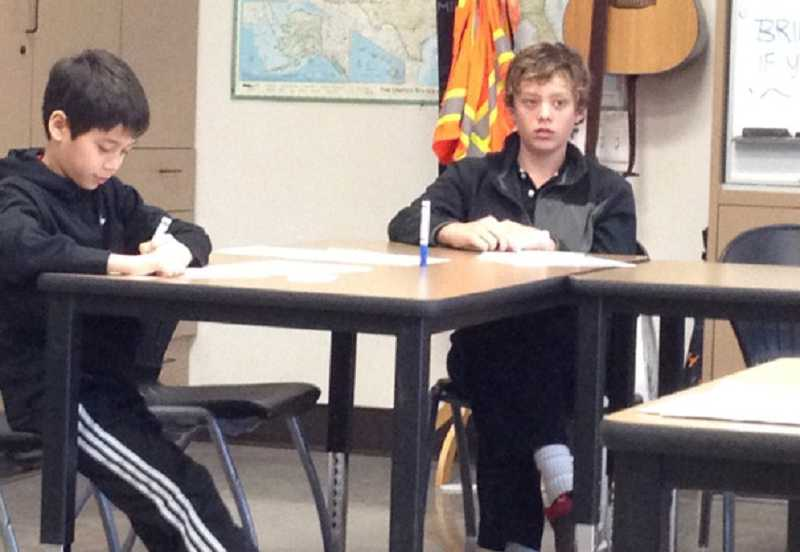by: SUBMITTED PHOTO: SHAUN ANDERSON-AHN - Eighth-grader Whitney Ahn narrowly defeated fifth-grader Clyde Beuter in the Riverdale Grade School Geography Bee.