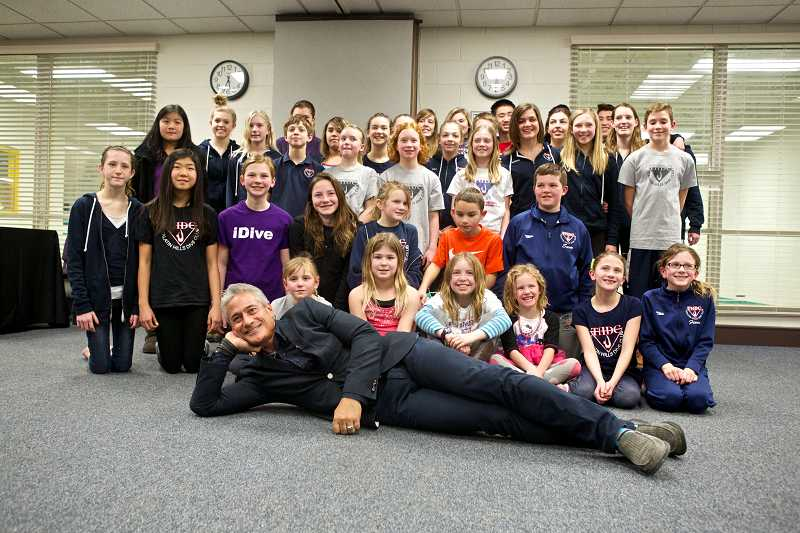 by: TIMES PHOTO: JAIME VALDEZ - Olympic gold medalist Greg Louganis poses for pictures with junior divers from the Tualatin Hills Dive Club.