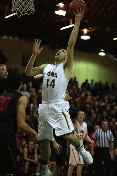 by: JON HOUSE - Ryan Shearmire elevates for a lay-up in West Linn's victory over Clackamas.