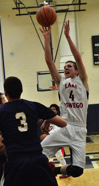 by: VERN UYETAKE - Mitch Verburg puts up a shot during the Lakers' win over Canby on the road.