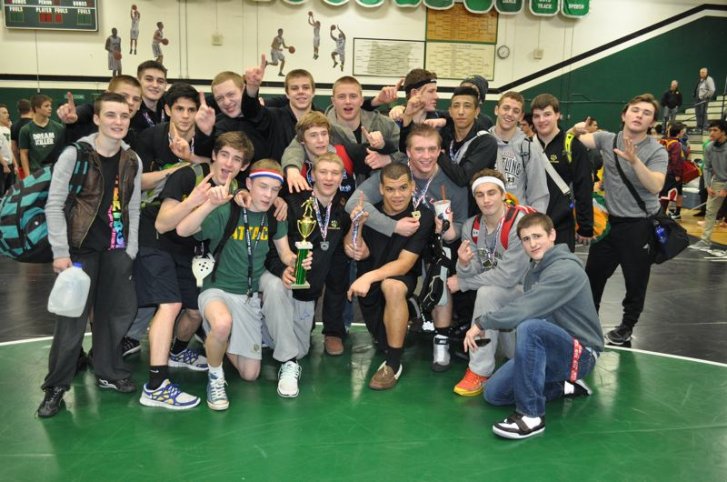 West Linn's wrestling team poses with its first-place trophy after winning the Tigard tournament over the weekend.