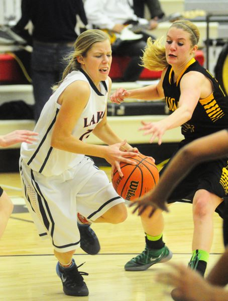 by: MATTHEW SHERMAN - Cami Dozois drives past West Linn's Genna Hughes in the Lakers' game against the Lions Tuesday.