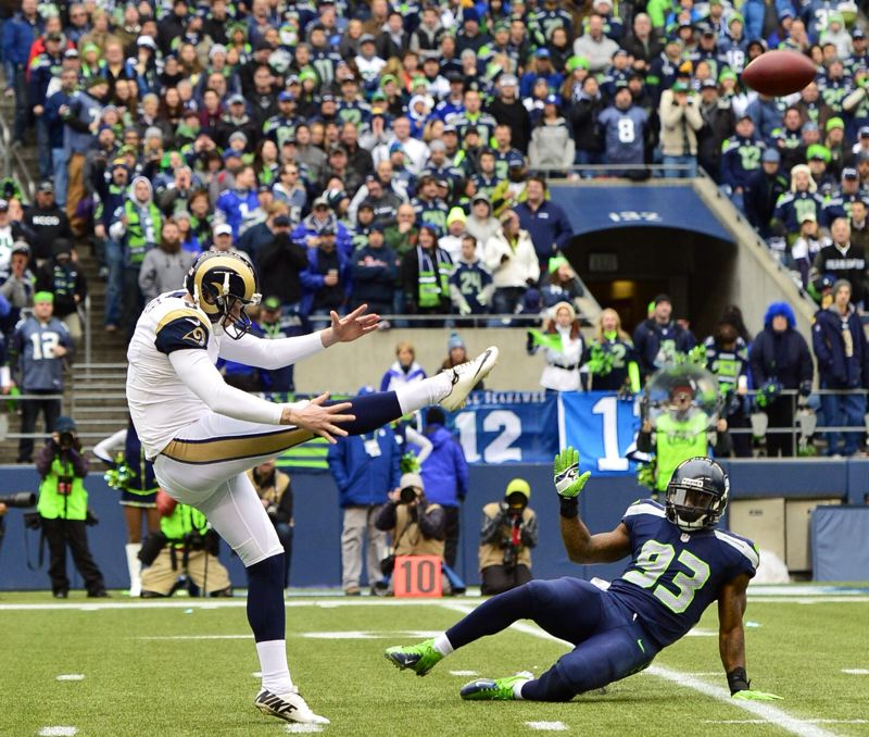 by: COURTESY OF MICHAEL WORKMAN - St. Louis Rams punter Johnny Hekker, a former Oregon State walk-on, gets one off against the Seattle Seahawks.