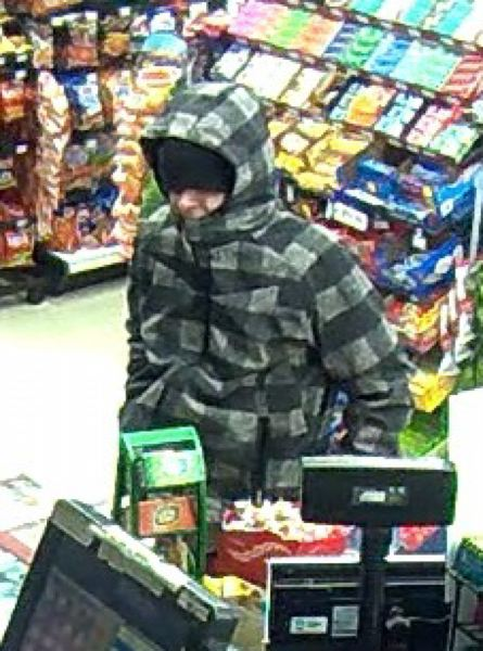 by: MULTNOMAH COUNTY SHERIFF'S OFFICE - Video shot of suspect in robberies in Gresham and Troutdale.