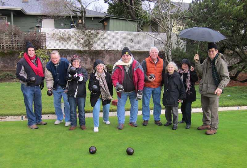 by: BARBARA SHERMAN - READY TO BRAVE THE ELEMENTS - Hardy members of the King City Lawn Bowling Club who ventured out on the bowling green on a recent rainy Saturday include (from left) David Mack, Ed Otte, Mary Clyburn, Candee Wilson, Loy Larsen, Steve Shobe, Sue Sutter, Beverly Simpson and Stan Halpin.