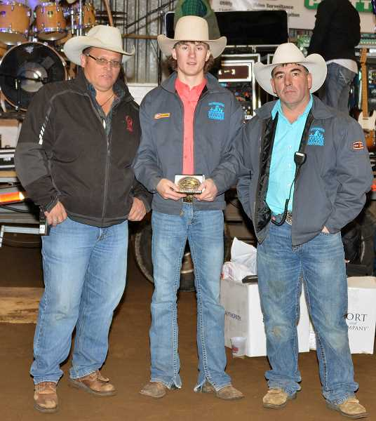by: PHOTO BY LINDA LARSON - Wrangler Howe of Madras (middle) was named the Professional Wild Horse Racers Association Rookie of the Year during the national championships Saturday, held at the Jefferson County Fair Complex. Association president Jason Smith (left) and Spud Smith (right) presented Howe with his buckle.