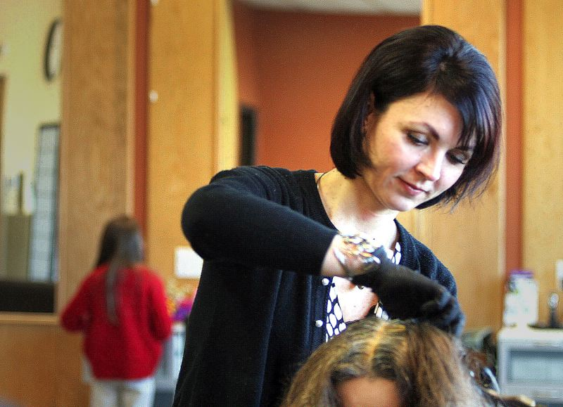 by: OUTLOOK PHOTO: JIM CLARK - Georgiana Calatean's Hair with Moxie began seven years ago and is now a full-service salon.