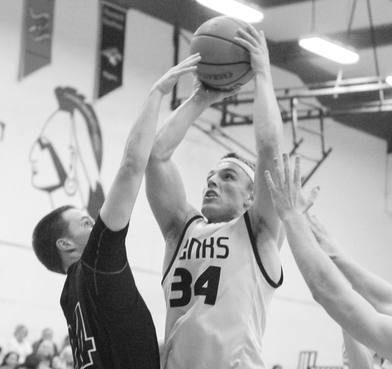 by: NEWS-TIMES PHOTO: CHASE ALLGOOD - Banks senior Aaron Streblow goes up for a shot against the Scappoose defense during last Friday's Cowapa League boys basketball game.