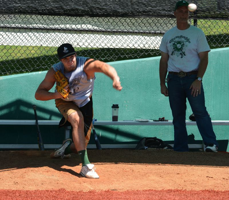 by: PAMPLIN MEDIA GROUP: MATT SINGLEDECKER - Christian Martinek of Jesuit High gets in some bullpen work during summer.