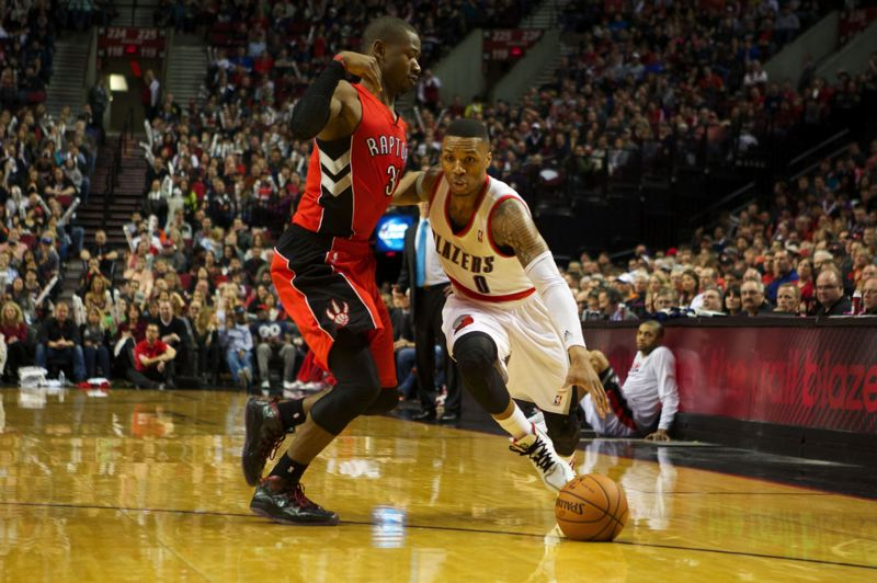 by: TRIBUNE PHOTO: JAIME VALDEZ - Terrence Ross tries to get in front of Blazers guard Damian Lillard.