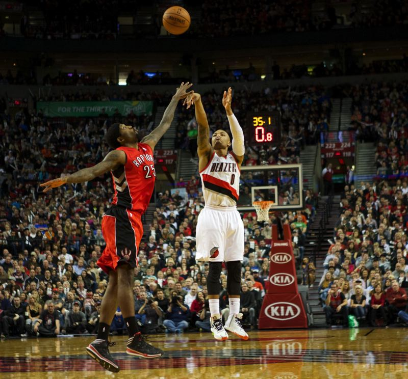 by: TRIBUNE PHOTO: JAIME VALDEZ - Damian Lillard sinks a 3-pointer over Toronto's John Salmons late in the third quarter.