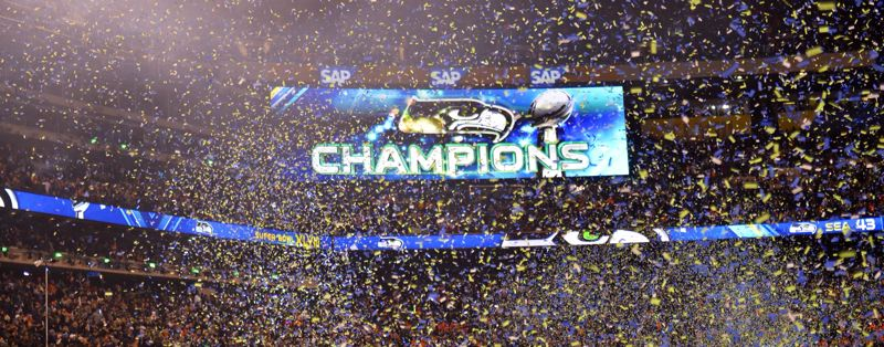 by: COURTESY OF MICHAEL WORKMAN - The scoreboard tells the story of Seattle's domination in Super Bowl XLVIII.