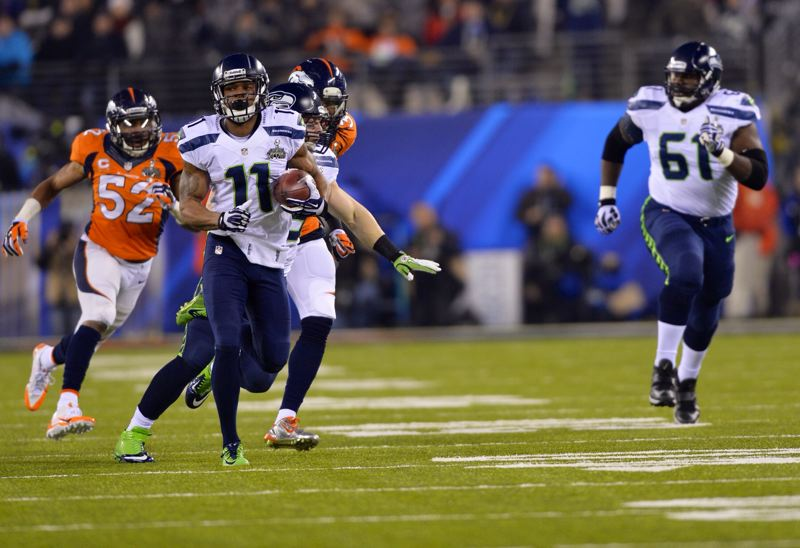 Seattle's Percy Harvin breaks through and then outruns the Denver coverage to open the second half with an 87-yard kickoff return for a touchdown.