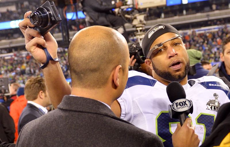 Seattle receiver Golden Tate has his own ways of capturing the postgame celebration, as the media nab him for an interview on the field.
