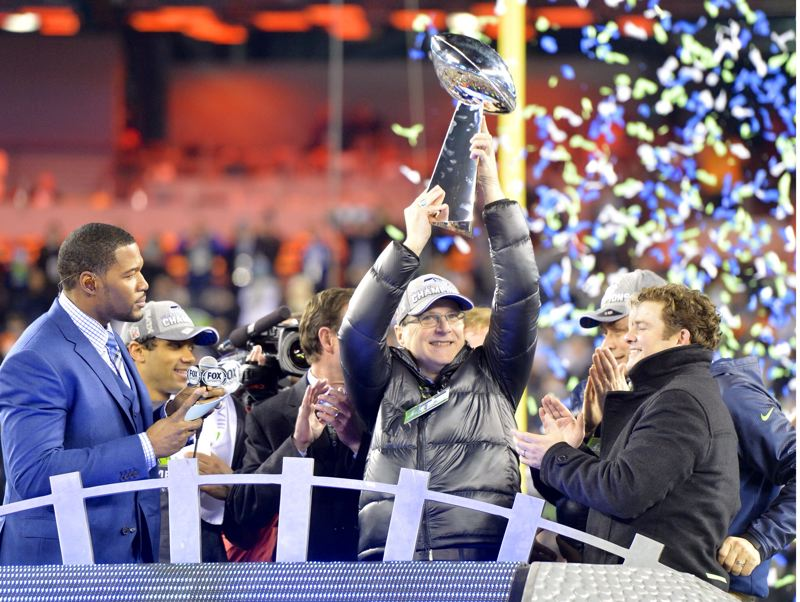 It's Paul Allen's turn to hold the Vince Lombardi Trophy, as the Seattle Seahawks owner and organization enjoy their first Super Bowl championship.