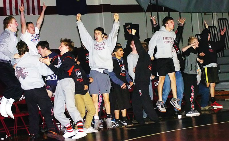 by: PAMPLIN MEDIA GROUP: DAN BROOD - Sandy wrestlers start celebrating as senior Dalton Davis pins Sherwoods Cameron Beebe in the 285-pound match. Davis win gave the Pioneers a 38-36 team victory.