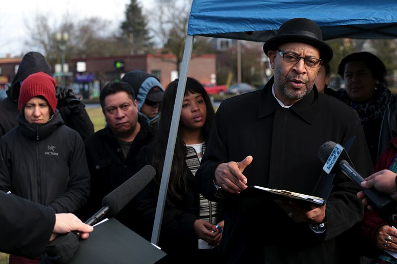 by: TRIBUNE PHOTO JONATHAN HOUSE - Tony Hopson (left), Founder and CEO/President and co-chair of the Portland African American Leadership Forum speaks at the press conference against the city's plan for a vacant Northeast Portland block on Monday.