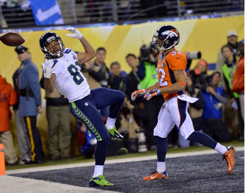 Seattle receiver Golden Tate draws an interference call on Denver defender Tony Carter.